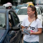 Yifat Gavishi, a Peace Now supporter, leafleting cars in Tel Aviv in September.  (Photo by Ted Lieverman)