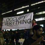 'Occupy Everything' sign (Photo by Angela Tyler-Rockstroh)