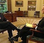 CBS correspondent Scott Pelley with President George W. Bush in 2002
