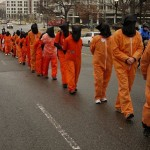 Demonstrators protesting the 10th anniversary of the Guantanamo Bay prison