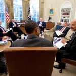 Director of National Intelligence James Clapper talks with President Barack Obama in the Oval Office, with John Brennan and other national security aides present. (Photo credit: Office of Director of National Intelligence)