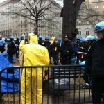 Police -- some in Hazmat suits -- clear away Occupy DC on Feb. 4 (Photo credit: OccupyWallStreet.org)