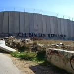 "Graffiti on the Palestinian side of Israel's ""separation wall"" recalls the words of John F. Kennedy in decrying the Berlin Wall with the words in German, ""I am a Berliner."" (Photo credit: Marc Venezia)"