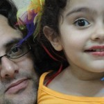 Assassinated Iranian scientist Dariush Rezaeinejad with child.