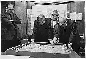 National Security Adviser Walt Rostow shows President Lyndon Johnson a model of a battle near Khe Sanh in Vietnam. (U.S. Archive Photo)