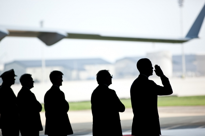 President Barack Obama saluting coffins of dead U.S. soldiers returned from Afghanistan to Dover Air Force Base. (White House photo by Pete Souza)