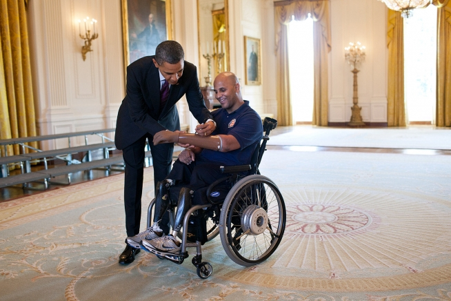 President Obama signs the prosthetic arm of Marine Sgt. Carlos Evans during a tour of the White House for wounded veterans on March 6, 2012. (White House photo by Pete Souza)