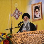 Iran's Supreme Leader Ali Khamenei, sitting under a portrait of his predecessor, Ayatollah Ruhollah Khomeini.