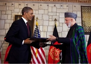 President Barack Obama and Afghan President Hamid Karzai exchange copies of the security agreement signed May 1, 2012, (White House photo by Pete Souza)