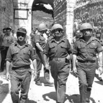 Israeli military commander Moshe Dayan (center) and his chief of staff Yitzhak Rabin (right) walking through Jerusalem during the Six-Day War. (Israeli archival photo)