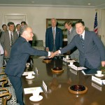 Israeli Prime Minister Yitzhak Shamir shaking hands with President Ronald Reagan's Defense Secretary Caspar Weinberger in 1982. (U.S. government photo)