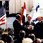 President Jimmy Carter with Egyptian President Anwar Sadat and Israeli Prime Minister Menachem Begin celebrating the Camp David peace accords. However, privately, Carter and Begin grew deeply distrustful of one another. (Photo credit: the Carter Center)