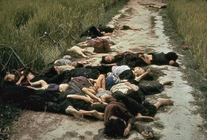 The bodies of Vietnamese men, women and children piled along a road in My Lai after a U.S. Army massacre on March 16, 1968. (Photo taken by U. S. Army photographer Ronald L. Haeberle)