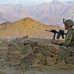 In Afghanistan, U.S. Army Pfc. Sean Serritelli provides security outside Combat Outpost Charkh on Aug. 23, 2012. (Photo credit: Spc. Alexandra Campo)
