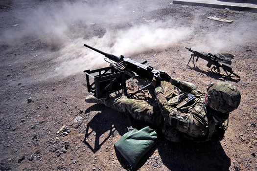 A U.S. soldier in Afghanistan fires an MA-2, .50-caliber machine gun, in a training exercise at the U.S. base in Afghanistan's Farah province on Sept. 22, 2012. (Photo credit: U.S. Defense Department)