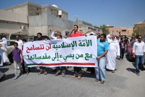 "A protest against ""Innocence of the Muslims,"" a video mocking the prophet Mohammad, in Duraz, Bahrain. The banner (in Arabic) reads: ""The Islamic nation will not tolerate with those who offend its sanctities."" (Photo credit, Mohamed CJ)"