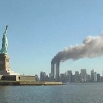 The World Trade Center's Twin Towers burning on 9/11. (Photo credit: National Park Service)