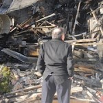 Ari Ben-Menashe gazing upon the wreckage of his house in Montreal on Dec. 6, 2012. (Photo by Robert Parry)