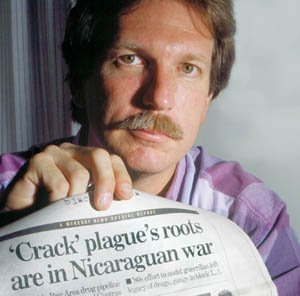 Journalist Gary Webb holding a copy of his Contra-cocaine article in the San Jose Mercury-News.