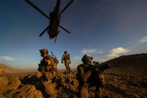 A U.S. military rescue team secures a landing site in Afghanistan after being being lowered from an HH-60 Pave Hawk during a mission Nov. 7, 2012. (U.S. Air Force photo/Staff Sgt. Jonathan Snyder)