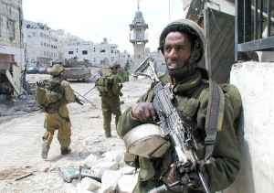 Israel Defense Force soldiers patrolling Nablus during the Second Intifada in 2002. (Photo credit: Israel Defense Forces)