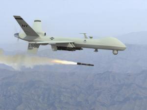 A Predator drone firing a missile.