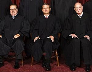 The three key right-wing justices on the U.S. Supreme Court, from left to right, Antonin Scalia, John Roberts and Anthony Kennedy. (From the official 2010 photo of the U.S. Supreme Court)