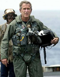 """President George W. Bush in a flight suit after landing on the USS Abraham Lincoln to give his """"Mission Accomplished"""" speech about the Iraq War."""