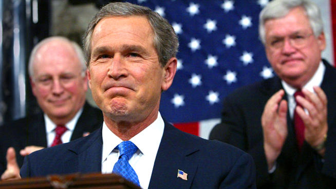 President George W. Bush receiving applause during his 2003 State of the Union Address in which he laid out a fraudulent case for invading Iraq.