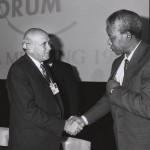 White South African leader Frederik deKlerk shaking hands with Nelson Mandela in 1992. (Copyright photo by World Economic Forum -- www.weforum.org)