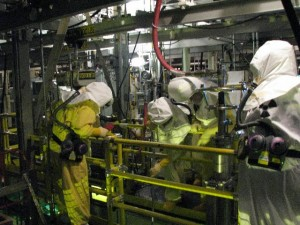 Workers at the Hanford nuclear facility work to transfer highly radioactive material into storage containers to be moved out of a facility near the the Columbia River. (Photo credit: hanford.gov)