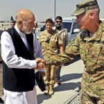 Afghan President Hamid Karzai greeting U.S. Army Lt. Gen. James L. Terry in Kabul, Afghanistan, in March 2013.