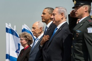 President Barack Obama stands with Israeli President Shimon Peres and Prime Minister Benjamin Netanyahu during the President's official arrival ceremony in Tel Aviv, Israel, in 2013. (Official White House Photo by Pete Souza)