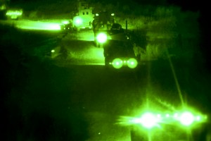 Seen through a night-vision device, U.S. Marines conduct a combat logistics patrol in Helmand province, Afghanistan, April 21, 2013. (U.S. Marine Corps photo by Sgt. Anthony L. Ortiz)