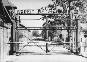 "The gate into the Auschwitz death camp with the cruelly ironic motto: ""Arbeit Macht Frei."""