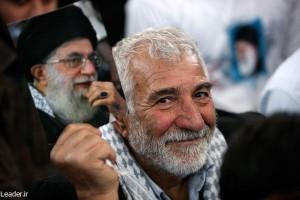 An Iranian man holding a photo of Supreme Leader Ali Khamenei. (Iranian government photo)