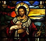Jesus as portrayed in stained glass as the Good Shepherd.