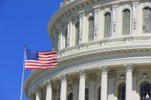 An American flag flying next to the dome of the U.S. Capitol. (Photo credit: Architect of the Capitol)