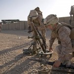 U.S. Marines setup an M224 60mm mortar during mission rehearsals on Camp Leatherneck in Helmand province, Afghanistan, July 20, 2013. (U.S. Marine Corps photo by Kowshon Ye)