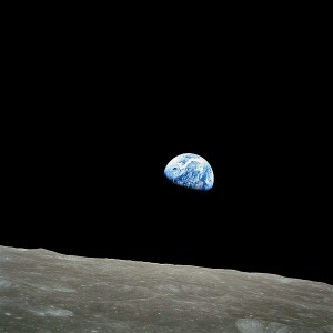 The image of the Earth rising over the surface of the moon, a photograph taken by the first U.S. astronauts to orbit the moon.
