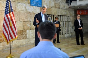U.S. Secretary of State John Kerry answers a question from an Israeli reporter during a news conference in Tel Aviv, Israel, on June 30, 2013.[State Department photo]