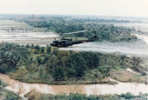 A U.S. military helicopter spraying the defoliant Agent Orange over Vietnam during the Vietnam War. (U.S. Army photo)