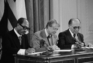 President Jimmy Carter signing the Camp David peace agreement with Egypt's Anwar Sadat and Israel's Menachem Begin.