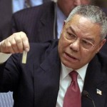U.S. Secretary of State Colin Powell presents a dummy vial of anthrax on Feb. 5, 2003, during a speech to the UN Security Council outlining the American case that Iraq possessed forbidden stockpiles of WMD.