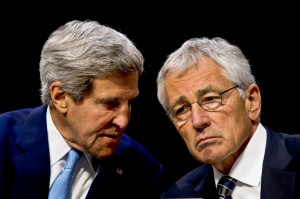 Defense Secretary Chuck Hagel, right, and Secretary of State John Kerry confer as they testify on the potential use of military force in Syria before the Senate Foreign Relations Committee in Washington, D.C., Sept. 3, 2013. (DOD photo by Erin A. Kirk-Cuomo)