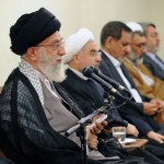 Iran's Supreme Leader Ali Khamenei sitting next to President Hassan Rouhani and addressing the cabinet.