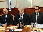 Israeli Prime Minister Benjamin Netanyahu (center at a cabinet meeting).