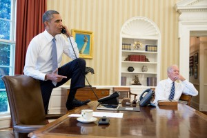 President Barack Obama talks on the phone with Speaker of the House John Boehner, in the Oval Office, Saturday, Aug. 31, 2013. Vice President Joe Biden listens at right. (Official White House Photo by Pete Souza)