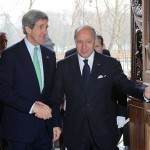 French Foreign Minister Laurent Fabius greets U.S. Secretary of State John Kerry in Paris, France, on Feb. 27, 2013. [State Department photo]