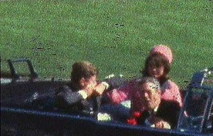 A frame from the Zapruder film capturing the first shot that struck President John F. Kennedy on Nov. 22, 1963.